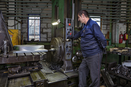 St. Petersburg, Russia - May 21, 2015: Turning Workshop Plant metal structures, work machine tool operator controls the process of drilling a steel part on a horizontal boring machine.