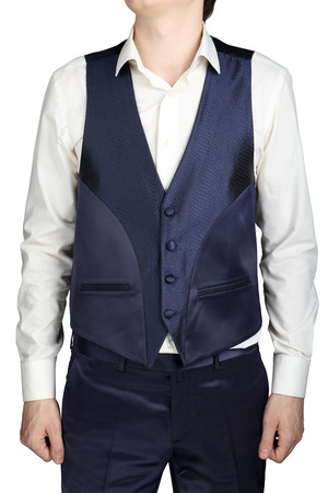 menswear: Blue mens vest, part of a wedding suit isolated on white background.