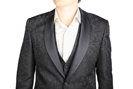eveningwear: Close-up of dark gray pattern wedding suit jacket, isolated on white.