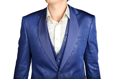 jacquard: Close-up of a suit jacket with a blue patterned jacquard  isolated on white background. Stock Photo