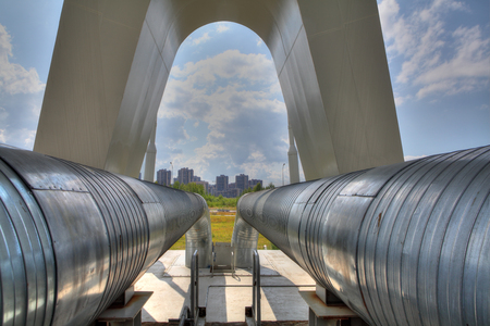 gas pipeline: St. Petersburg, Russia - July 9, 2015: Steel pipes of heating main in the city district Editorial
