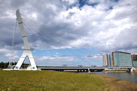 gass: St. Petersburg, Russia - July 9, 2015: Cable-stayed bridge with a heating main on Dudergofskiy channel.