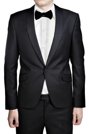 noeud papillon: Robe de soirée gris foncé pour les hommes; blazer; chemise blanche; n?ud papillon; isolé sur fond blanc. Banque d'images