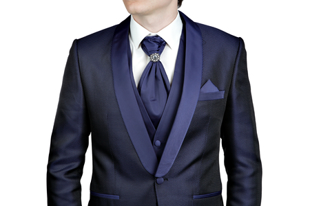 plastron: Navy blue suit for men, a wedding or prom, vest, shirt, tie plastron with a brooch, close-up, isolated on a white background.