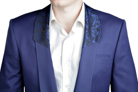 lapels: Close-up dark blue suit jacket, shawl collar with a wide lapel, black ornamental pattern at the top. Stock Photo