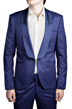 lapels: Navy blue mens suit jacket, without buttonholes, unbuttoned, with no buttons, clasp chain closure, shawl collar with a wide lapel, black ornamental pattern at the top, isolated over white. Stock Photo