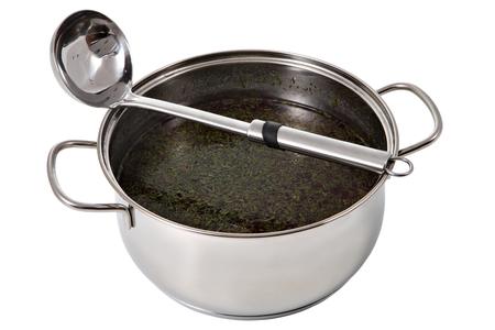 steel pan: Cacerola de acero con sopa y cuchara de acero inoxidable, aislado en un fondo blanco. Foto de archivo