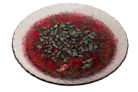 sou: Bowl of translucent gray glass, cold beet soup, decorated with dill and chopped green onion isolated on white background.