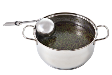 bailer: Soup ladle stainless steel lies in a pot of broth, isolated on white background.