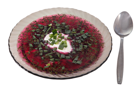 stainles steel: Plate of transparent glass dark, cold beetroot soup, Russian borscht decorated sour cream and chopped green onion isolated on white. Stock Photo
