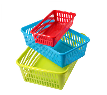 small articles: Household storage system, set colored plastic baskets of various sizes, different colors, isolated on a white background. Stock Photo