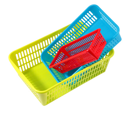 small articles: Plastic household articles, colored containers of different sizes, three small storage baskets isolated on white.