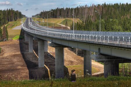 autobahn: Saint Petersburg, Russia - August 7, 2015: Four-line speed highway St. Petersburg - Sortavala, in Leningrad region, conservation area, new modern steel highway bridge on reinforced concrete supports.