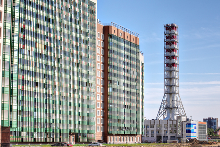 energy suppliers: St. Petersburg, Russia - July 6, 2015: district heating plant chimney, modern industrial boiler, modular boiler house Editorial