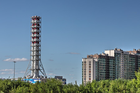 power suppliers: St. Petersburg, Russia - July 6, 2015: New modern gas boiler house in a residential area of the city, district heating plant chimney, modular boiler