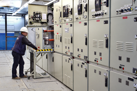 Kovdor, Murmansk region, Russia - September 3, 2007: Electrical Switchgear room of mining plant, Metal-Clad electrical cabinet, engineer control  Indoor High Voltage Vacuum DC Circuit Breaker.