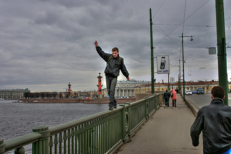 intrepid: St. Petersburg, Russia - April 22, 2006: Unidentified man risked his life to pass on parapet, Birzhevoy bridge.