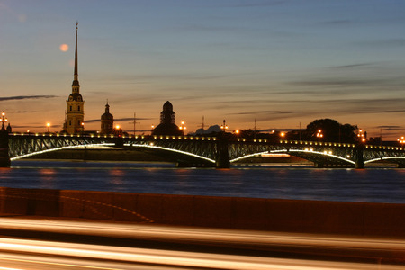 places of interest: Evening view of the Troitsky Bridge and Peter and Paul Fortress in St. Petersburg, Russia.