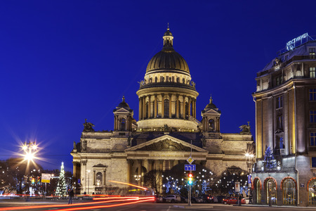 isaac: St. Petersburg, Russia - December 27, 2015: St. Isaac Cathedral in the evening light, Christmas decorations on St. Isaacs Square in Saint Petersburg. Editorial