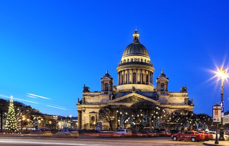 isaac: St. Petersburg, Russia - December 27, 2015: St. Isaac Cathedral in the evening light, Night view Pre-Christmas decoration of St. Isaacs Square in Saint-Petersburg. Editorial