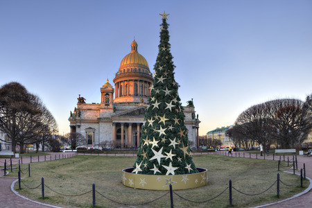 isaac: St. Petersburg, Russia - December 27, 2015: St. Isaac Cathedral in sunset, New Year Eve Saint Petersburg, decorated Christmas tree on St. Isaacs Square.