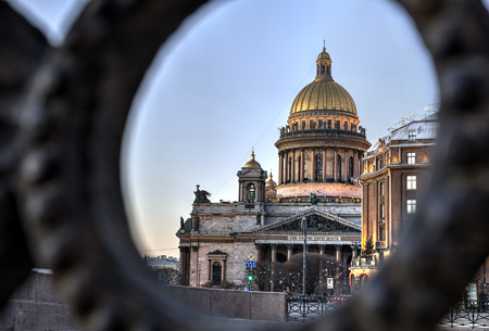 isaac: St. Petersburg, Russia - December 27, 2015: St. Isaac Cathedral in the evening light, View through the iron fence Moika Embankment.
