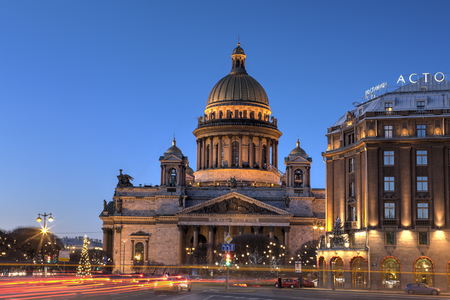 isaac: St. Petersburg, Russia - December 27, 2015: St. Isaacs Square in the winter before the new year with Christmas decorations, St. Isaac Cathedral in the evening light.