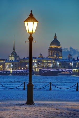 dome building: Winter evening in Saint Petersburg, Russia view of the Palace Bridge, Admiralty building and the dome of St. Isaacs Cathedral.