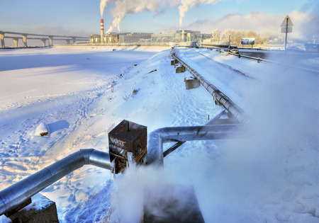 coatings: St.Petersburg, Russia - January 23, 2016: Outdoor Overhead insulated the pipeline hot water supply, Kanonersky Island in Saint Petersburg.