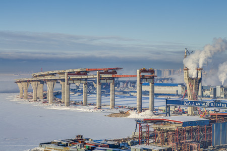 two level house: St.Petersburg, Russia - January 23, 2016: Double-deck road bridge overpass across the sea channel in Saint-Petersburg built in a part of the central section of the Western High-Speed Diameter (WHSD).