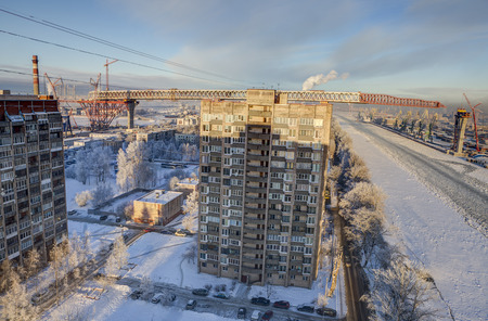 two level house: St.Petersburg, Russia - January 23, 2016: Kanonersky island of Saint Petersburg, the construction of the overpass bridge the motorway as part of Western High Speed Diameter.