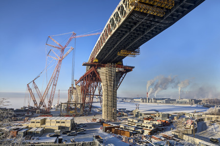 two level house: St.Petersburg, Russia - January 23, 2016: Road bridge, under construction, building of a double highway bridge, the Western High-Speed Diameter, through Sea Canal Saint Petersburg, sunny winter day.