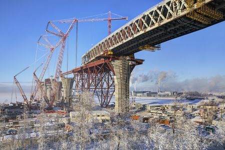 two level house: St.Petersburg; Russia - January 23; 2016: Double-deck road bridge overpass across the Sea Canal in Saint-Petersburg under construction; Kanonersky island; winter day.