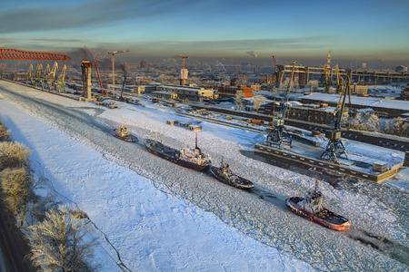 erection: St.Petersburg, Russia - January 23, 2016: Freight port of Saint Petersburg, Sea Channel, sliding of bridge constructions at erection highway bridge, winter.