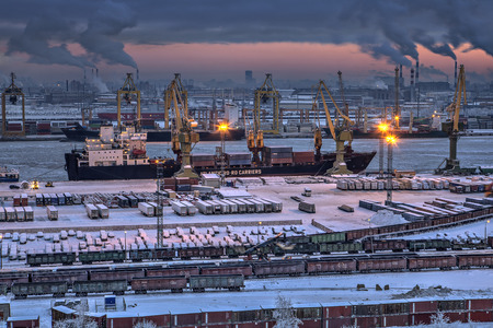 sea port: St.Petersburg, Russia - January 23, 2016: Top view of the night cargo port of Saint Petersburg , loading and unloading operations on a container ship, winter time.