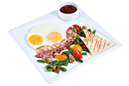 english breakfast: English breakfast, fried eggs sunny side up with bacon, vegetables and toast bread, on a square serving plate isolated on white background.
