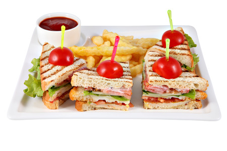 chicken fillet: Club sandwich with chicken fillet, French fries, tomato sauce, on white rectangular plate isolated on white background.
