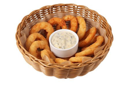 basketful: Onion rings in bowl wicker straw,  isolated on white background.