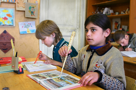 classbook: Podol village, Tver region, Russia - May 5, 2006: Youngest schoolgirl Rosa Martirosyan 8 years old meets a lesson in the classroom of rural school. Editorial
