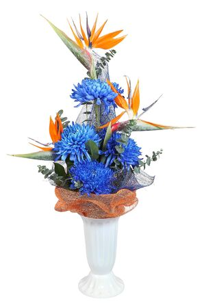 mixed flower bouquet: Florist designed bouquet in plastic vase, deep blue autumn chrysanthemum, and heliconia, isolated on white background.