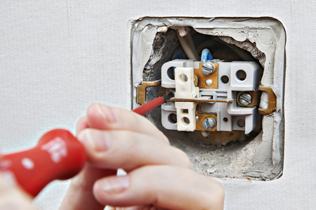 disassembly: Replacing damaged light switch, disassembly of the old appliance close-up.