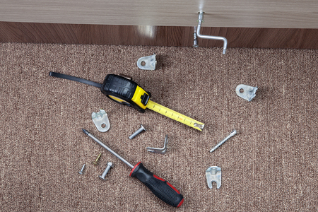 fasteners: Steel fasteners, brackets and hand tools to install furniture.