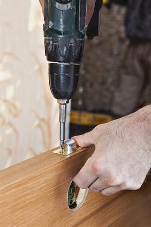 door knobs: Door installation, mount locked door knobs, hands handyman carpenter at interior wood door lock installing. Stock Photo
