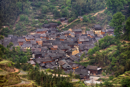 agriculturalist: Small hamlet of ethnic minority Dong, near the village of Zhaoxing, top view, daylight, cloudy, spring, Jilun Dong Village, Guizhou Province, China.