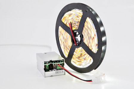 led lighting: Luminescent diode LED tape on the coil attached to the DC converter. Stock Photo