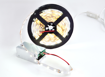 led lighting: Close-up Bobbin shining LED strip light connected to a DC converter. Stock Photo