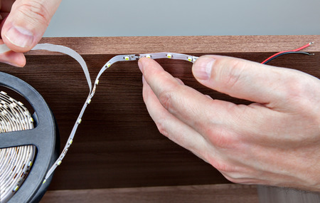 led lighting: Installation of decorative LED lighting inside the furniture. Stock Photo