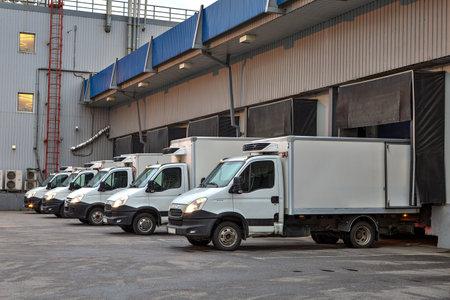 loading bay: Saint-Petersburg, Russia - October 31, 2016: trucks fleet  at loading dock shipping industry.