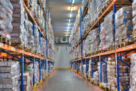 Saint-Petersburg, Russia - October 31, 2016: Shelves and racks in distribution cold storage warehouse interior. Sajtókép