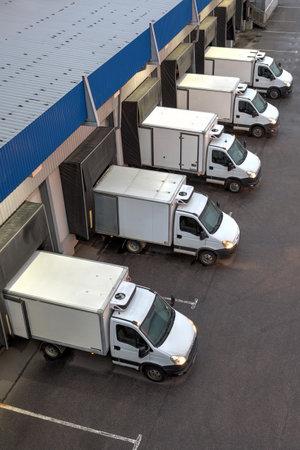 Saint-Petersburg, Russia - October 31, 2016: Top viev row of trucks at a loading dock.